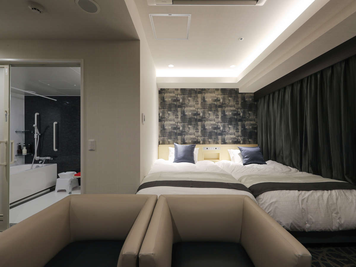 シモンズ製ベッドでゆっくり休めるデラックスツイン