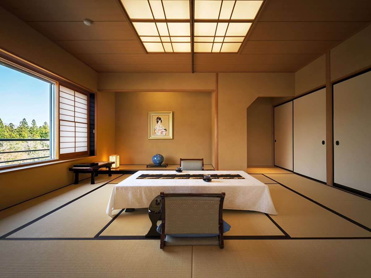 【貴賓室】清流名取川を臨む、和室12畳+洋間ツイン+リビングのお部屋です。最上階5階角部屋。