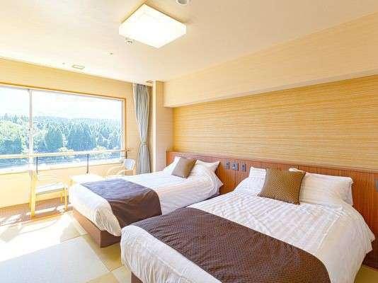 和室ベッドタイプ(トイレ付)琉球調の畳の上にセミダブルベッド2台を備えたモダンなお部屋です。