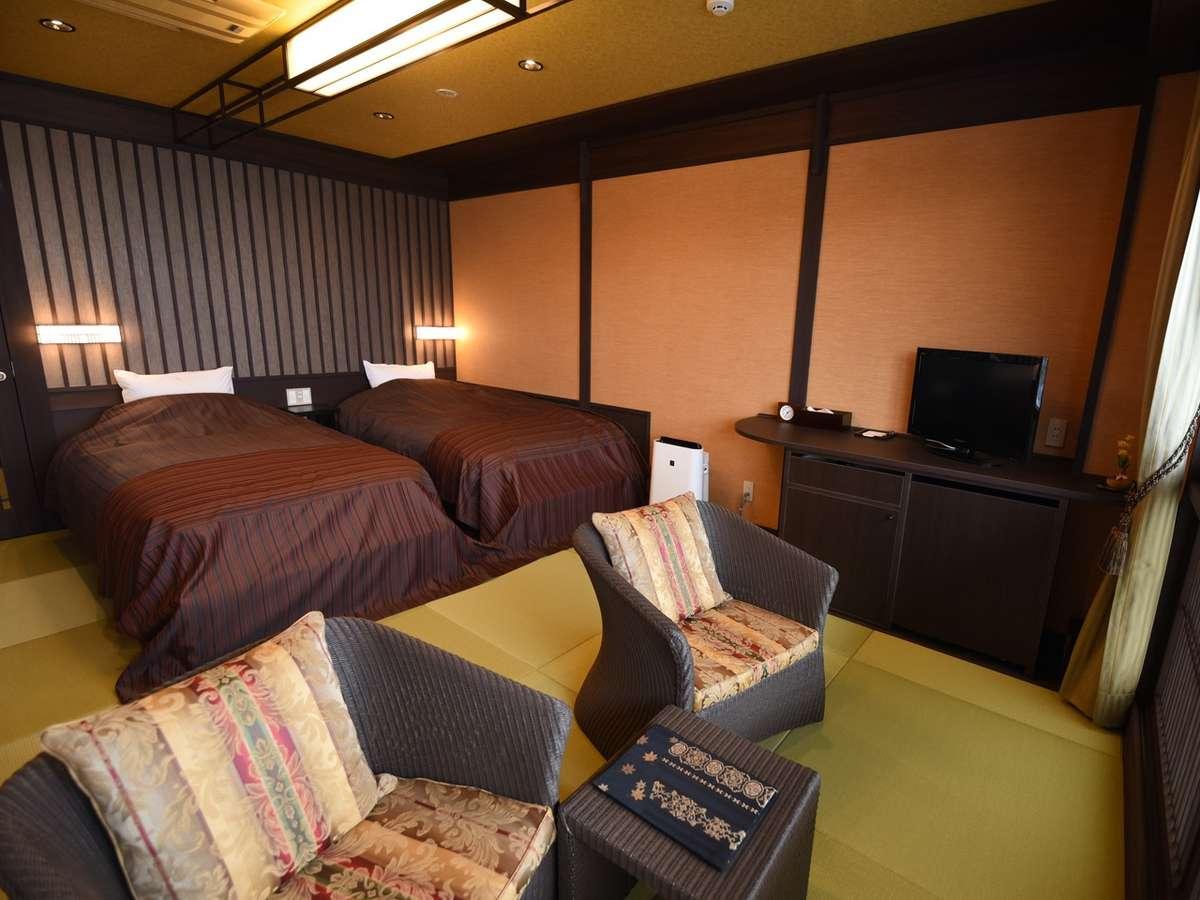 鳰:洋のスパイスも取り入れたモダンなお部屋。全畳敷きで、のんびり、ごゆるりとおくつろぎくださいませ。