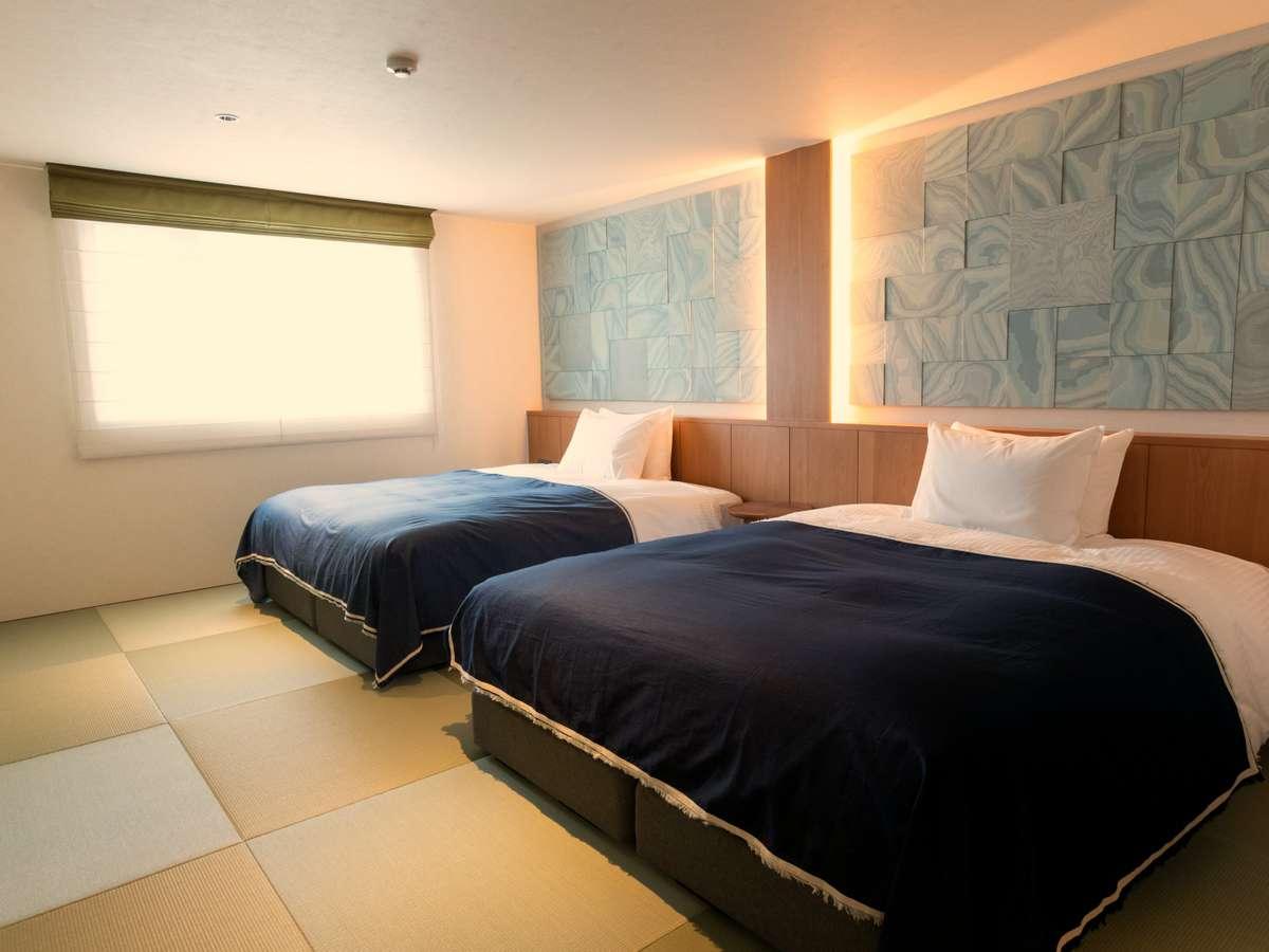 【畳付きツインスイートルームA】広々とした小上がりのお部屋。