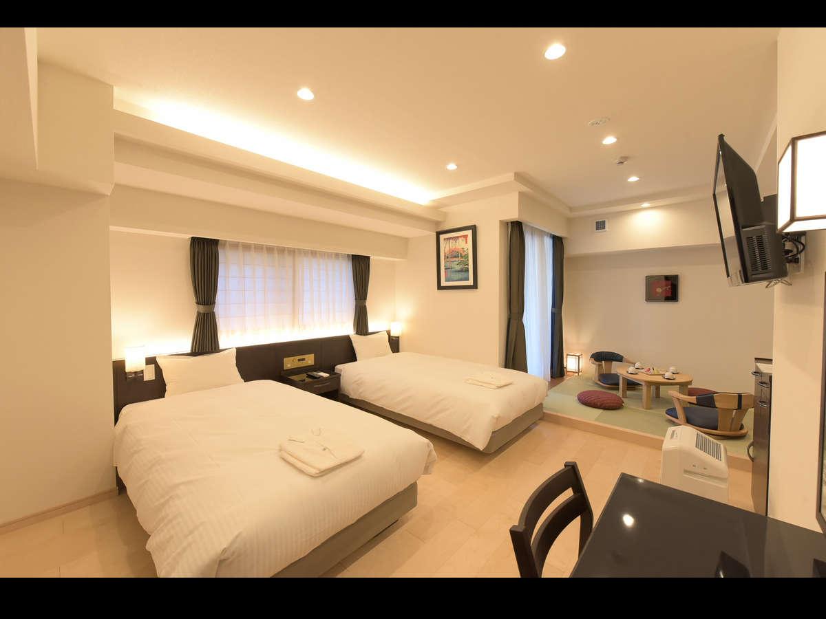 団欒スペースの座敷が付いた和洋室になります。
