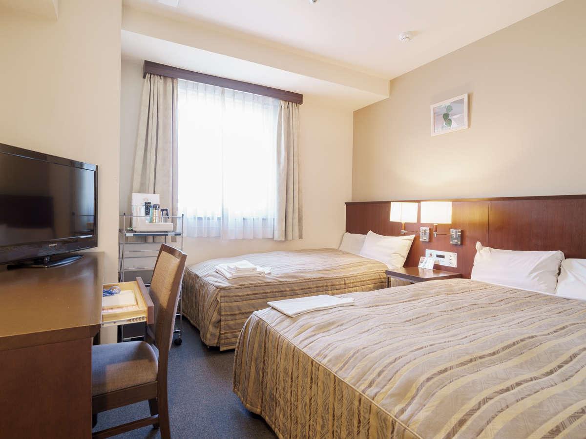 【ツインルーム】140cm幅と100cm幅のベッドが各1台ずつ