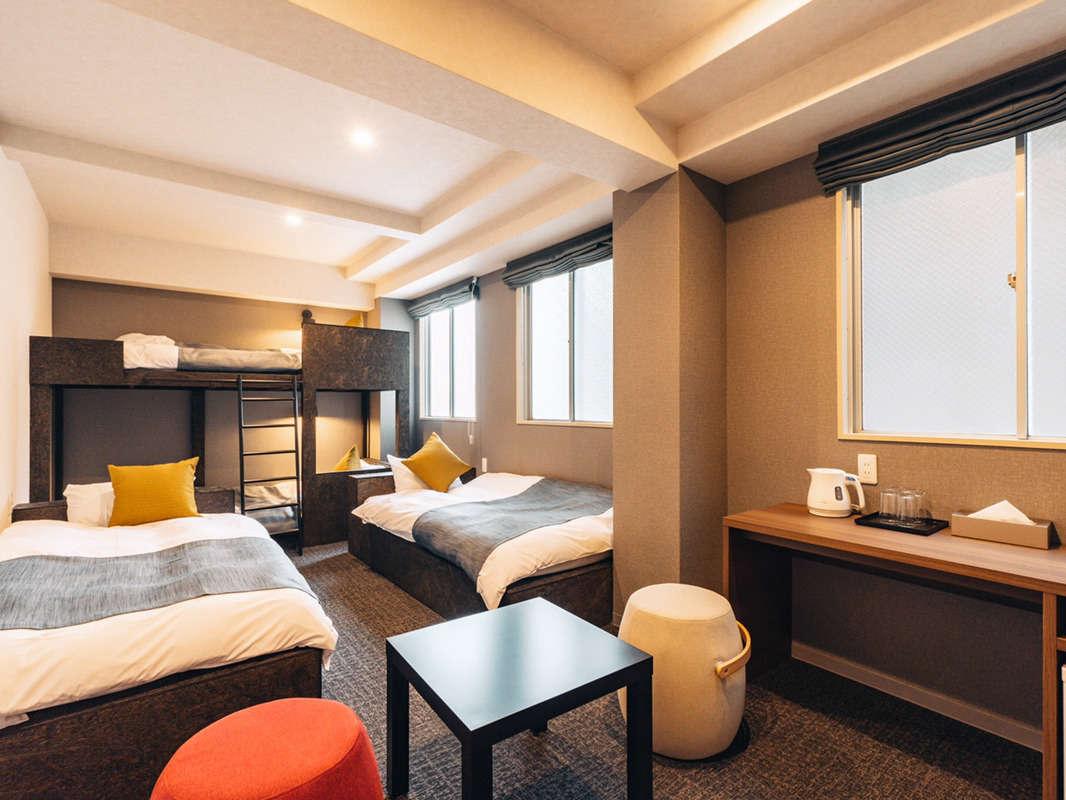 大きめのシングルベッドがあるお部屋はゆっくり寛ぐのに最適