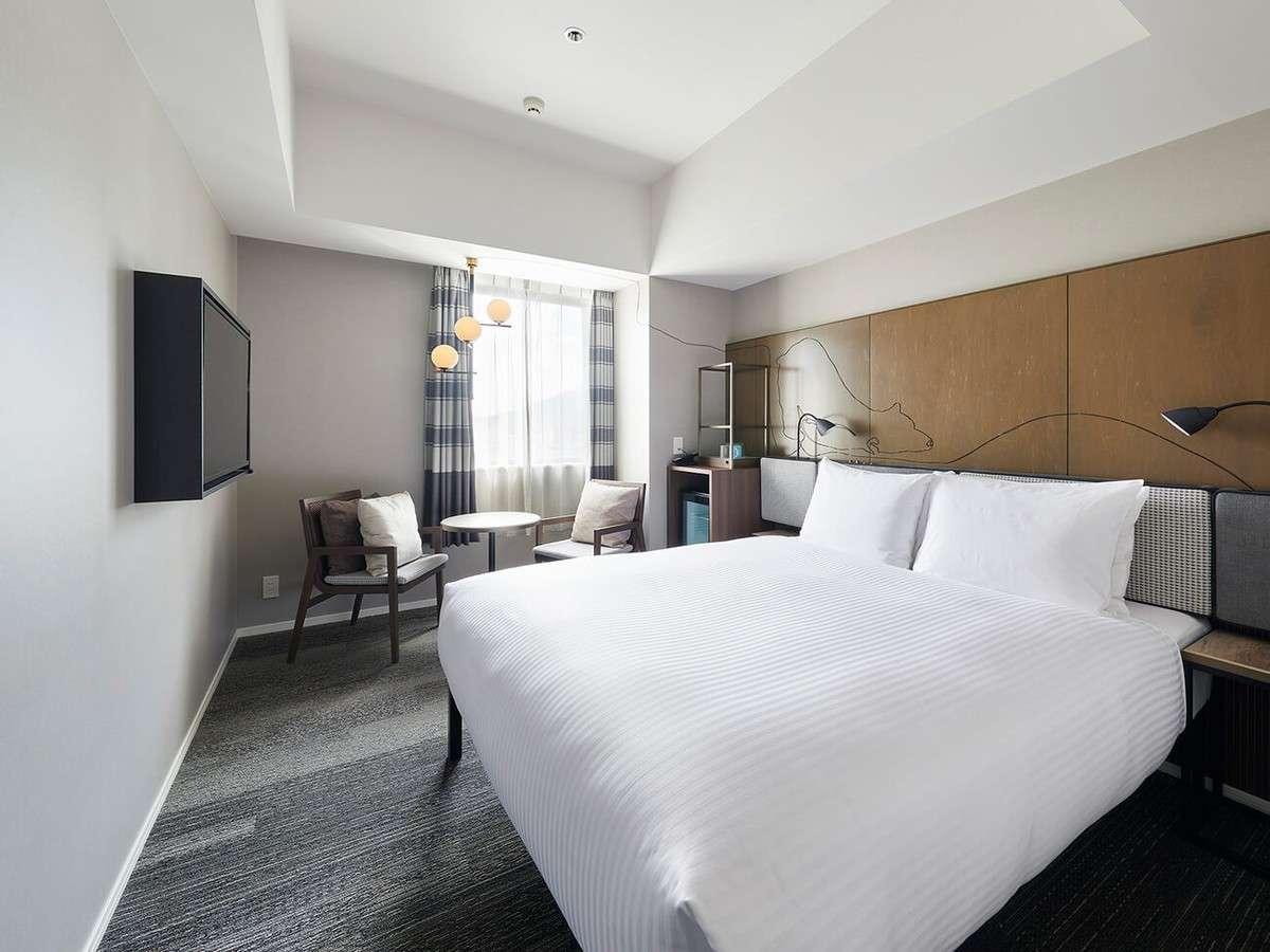 【デラックスダブル】19.20~19.50㎡/広々とした160cm幅のベッドが快適な睡眠をお約束