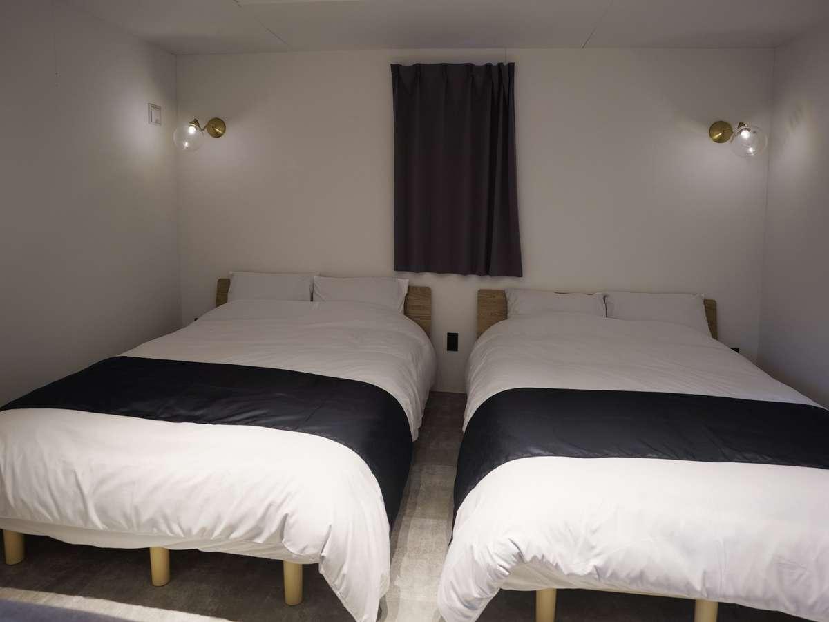 洋室にはツインルームのベッドルーム付き