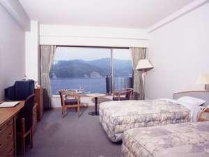マリンポートホテル海士:洋室ツインタイプです。エキストラベッドにより3名まで対応可。