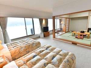 ツイン+8畳の和洋室タイプのお部屋です。