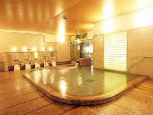 宮島ホテルまこと:石を基調にした女性用大浴場。広々とした大浴場で旅の疲れを癒して下さいませ。