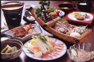 観光ホテル 門倉亭 南荘:島料理(種子島の郷土料理)をご賞味ください。