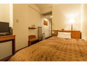 ターミナルホテル東予:機能的でセミダブルベッド完備のシングルルーム。寛ぎのひと時をお約束します。
