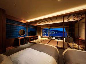 熱海後楽園ホテル:エクセレンシィルーム一例。青をベースとしたシックな内装。