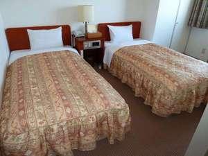 グリーンホテル米子:静かで、ゆったりとおくつろぎいただけるツインルーム。
