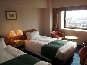 ホテルニューオータニ鳥取:スタンダードツインルーム。エキストラベッドをセットする事により、3名様まで対応可能。