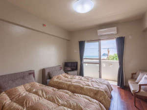 海人の宿:お部屋によってベットが異なります。