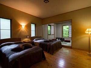 【客室】ツインベッドルーム+和室からなる和洋室は、段差を少なくしております/客室例