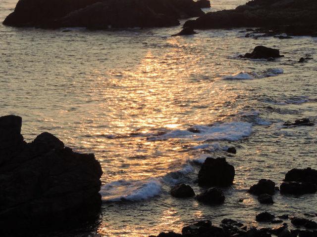 西日を映して_潮岬灯台